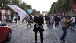 An opponent of gay marriage takes his protest to the Champs Elysées earlier this year