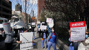 Members of the medical staff listen as Montefiore Medical Center nurses call for N95 masks and other 'critical' PPE to handle the coronavirus (COVID-19) pandemic on April 1, 2020 in New York
