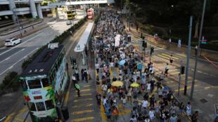 Đoàn biểu tình phản đối án tù cho ba nhà đấu tranh dân chủ tại Hồng Kông ngày 20/08/2017