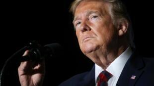 Interrogé sur sa volonté d'accorder le droit de grâce à certains de ses proches, Donald Trump (notre photo) est resté évasif.