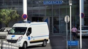 Ambulance at emergency entrance of hospital in France