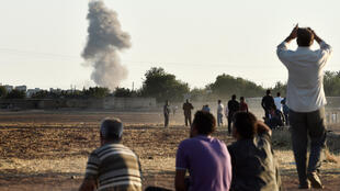 Kurds watch air strikes against IS outside Kobane
