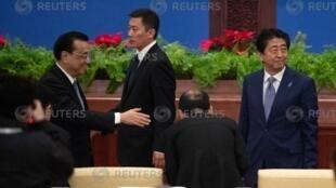 日本首相安倍晉三和中國總理李克強在《中日友好條約》締結40周年紀念儀式上