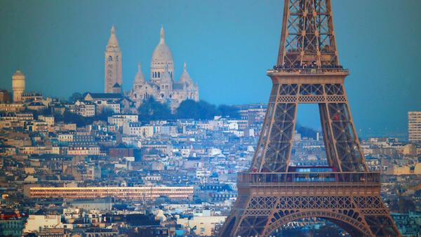 The Eiffel Tower and the Sacre Coeur Basilica in Paris - how many rats are there in those streets?