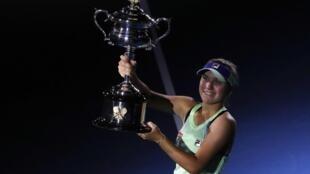 Sofia Kenin won her first Grand Slam title at the Australian Open following a victory in three sets over Garbine Muguruza.