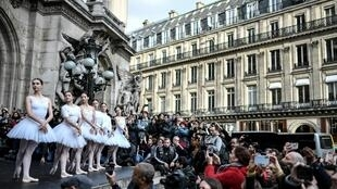 Paris Opera dancers, currently on strike, perform an extract of Swan Lake in front of the Opera Garnier on 24 December, 2019.