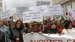 French demonstrators hold a banner to protest against the Spanish government plan to limit abortions, Marseille, 1 February, 2014