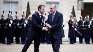 French President Emmanuel Macron with Turkey's Recep Tayyip Erdogan at the Elysée on 5 January