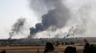 Smoke rises over the Syrian town of Tel Abyad, as seen from the Turkish border town of Akcakale in Sanliurfa province, Turkey, October 10, 2019.