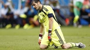 Spain's goalkeeper Iker Casillas reacts after a goal by the Netherlands