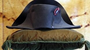 A black felt two-cornered hat belonging to French Emperor Napoleon Bonaparte on display at the Osenat auction house in Paris