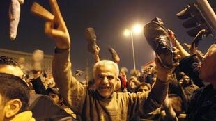 Protesters react in Tahrir Square to Egyptian President Hosni Mubarak's televised speech in Cairo