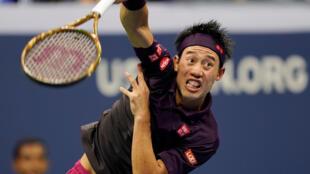 Kei Nishikori of Japan hits to Novak Djokovic of Serbia in a men's semi-final match on day twelve of the 2018 U.S. Open tennis tournament at USTA Billie Jean King National Tennis Center