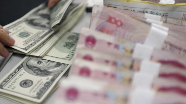 Banco Central da China aumentou a cotação do iuane em relação ao dólar
