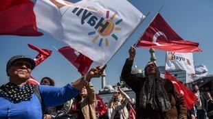 People wave flags during a No campaign event in Istanbul's Eminonu district.