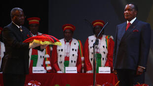 Congolese President Denis Sassou Nguesso (R) receives the insignia of the presidency during his inauguration ceremony on April 16, 2016 in Brazzaville.