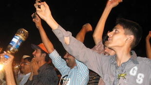PML-N supporters celebrate victory at Nawaz Sharif's HQ on Saturday night