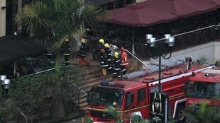 Firefighters enter Westgate shopping centre after explosions at the mall in Nairobi