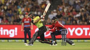 Australia's batsman Glenn Maxwell plays a shot as England's wicketkeeper Jos Butller looks on during the Twenty20 International Tri-Series cricket match between England and Australia.