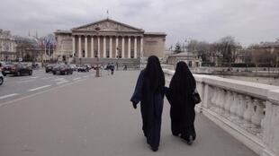 Women wearing niqab in front of Assemblée Nationale in Paris