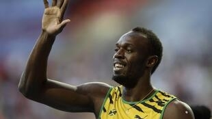 Usain Bolt of Jamaica celebrates winning the men's 200 metres final during the IAAF World Athletics Championships