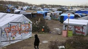 This file picture shows the migrant camp in Calais. A court in the city of Lille rejected an application by authorities in Calais for interim closure of unlicensed shops in the camp.