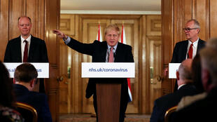 Unlike in many other European countries, UK Prime Minister Boris Johnson has kept schools open on advice from chief medical officer for England Chris Whitty (L) and government chief scientific officer Patrick Vallance (R)