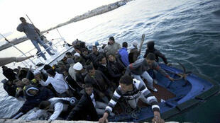 North African refugees arriving at Lampedusa port 12 April 2011.