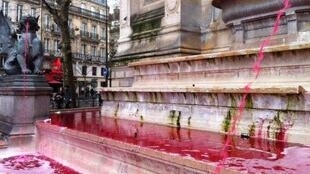 The Fontaine Saint Michel in Paris after the French NGO Action contre la Faim poured dye into it.