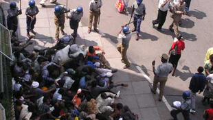 Police break up a demonsration in Harare