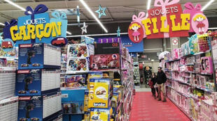 Toy aisle, with blue toys for boys on the left and pink toys for girls on the right