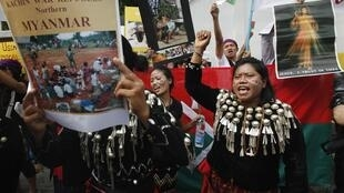 A group of native Kachin living in Thailand hold banners and shout slogans as they protest in front of Myanmar's embassy in Bangkok January 11, 2013