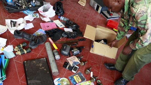 Hand grenades and other items are displayed by police after a raid at a mosque in Mombasa on 17 November, 2014