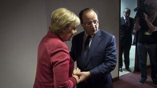 French President François Hollande and German Chancellor Angela Merkel at the EU summit in Brussels