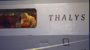 French investigators inspect the Thalys train where a gunman opened fire