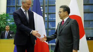 French Finance Minister Bruno Le Maire shakes hands with Japan's Minister of Economy, Hiroshige Seko after a meeting around Renault-Nissan following the arrest of its Chairman Carlos Ghosn in Japan on suspicions of misuse of company funds, in Paris, France