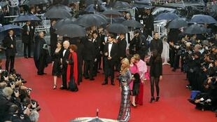 Rain soaks the red carpet at Cannes as guests arrive for the screening of the film 'Jimmy P.' (Psychotherapy of a Plains Indian) this week