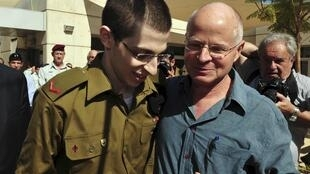 Gilad Shalit stands with his father Noam at Tel Nof air base in central Israel.
