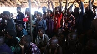 FDLR ex-combatants in a camp in Kisangani, DRC, during UN high official DRSRG David Gressly visit, July 2015.