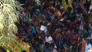 Workers in a protest in front of the Tazreen Fashions garment factory in Bangladesh, 30 November 2012