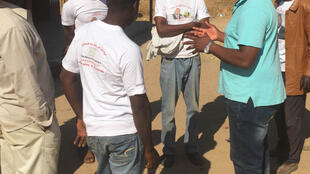 Maxwell Shumba (right), president of ZimFirst political party, speaking to constituents in rural Zimbabwe