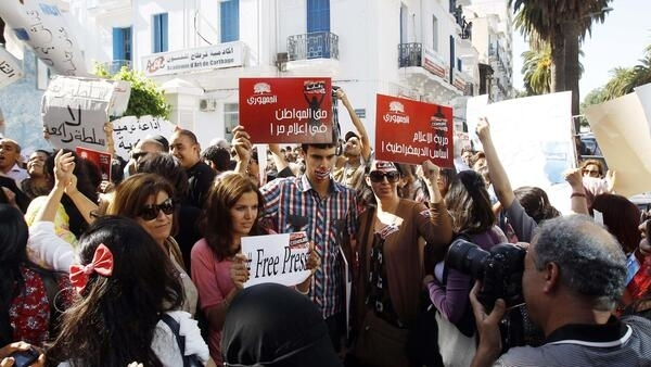 Tunisian journalists went on strike on Wednesday, piling pressure on the Islamist government they accuse of restricting freedom of speech after a revolt toppled the country's autocratic leader last year.
