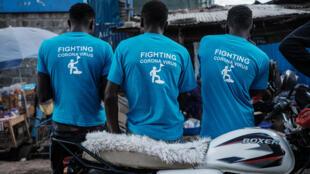 Grassroots against coronavirus: A Kenyan group called Shining Hope for Communities promotes hand hygiene in the Nairobi slum of Kibera