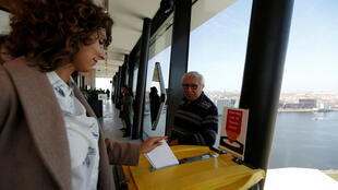 People vote at the ADAM Tower in Amsterdam on 15 March, 2017.