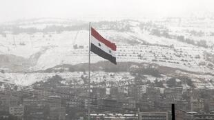 Snow-covered Mount Qassioun overlooking Damascus