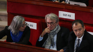 Jean-Claude Mailly of the FO union (centre) listens to Hollande's opening speech at the social conference
