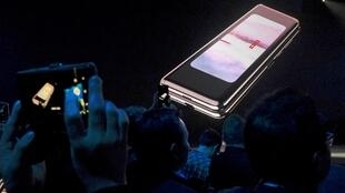 The Samsung Galaxy Fold phone is shown on a screen at Samsung Electronics Co Ltd's Unpacked event in San Francisco, California, U.S., February 20, 2019
