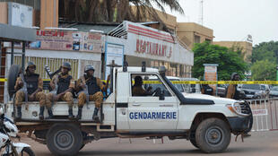 Security forces deploy to secure the area after an overnight raid on a restaurant in Ouagadougou, Burkina Faso August 14, 2017