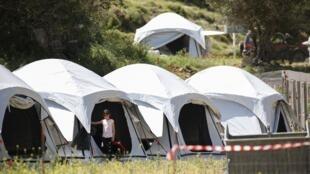 Dans un camp temporaire pour réfugiés et migrants nouvellement arrivés,sur l'île de Lesbos, Grèce, le 13 mai 2020.