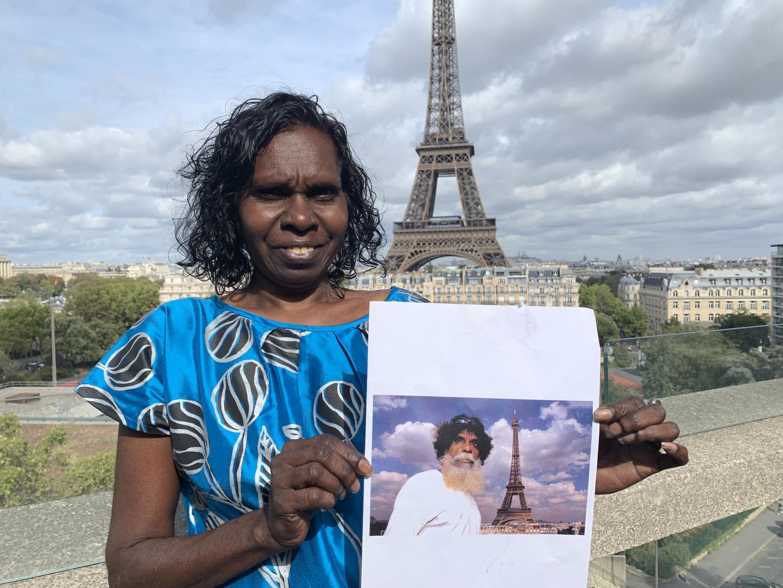 Deborah Wurrkidj with a photo of artist John Marwundjul, Paris, 30 Sept 2019
